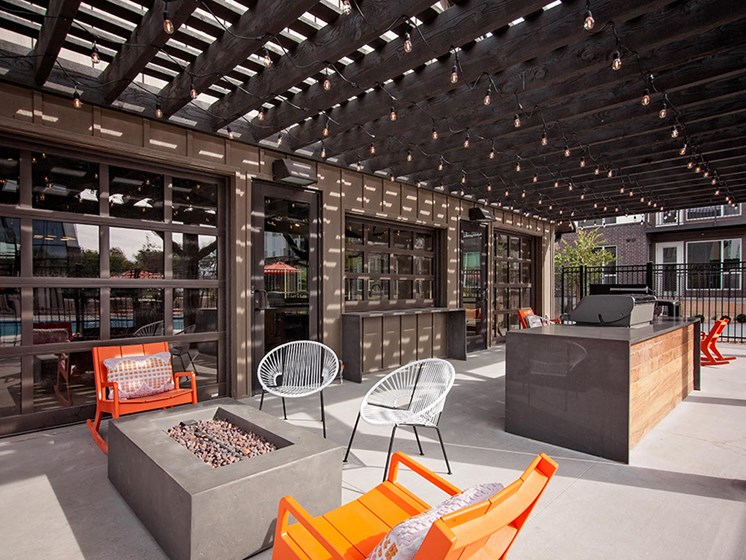 Outdoor courtyard with firepit, seating area and barbeque grill