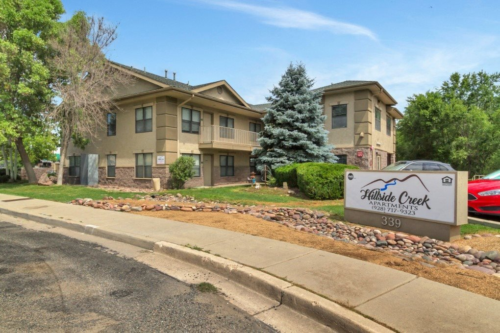 Exterior, landscaping & signage at Hillside Creek Apartments in Prescott, AZ