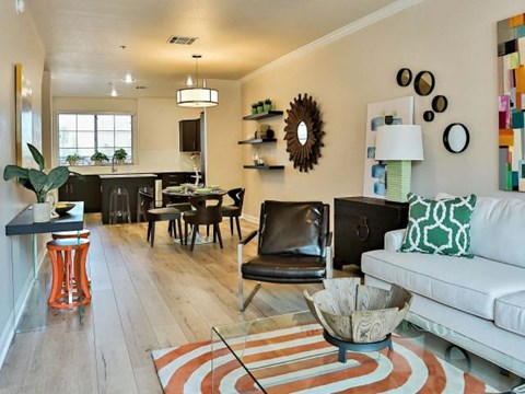 The Highland Apartments open living floorplan with living room and kitchen