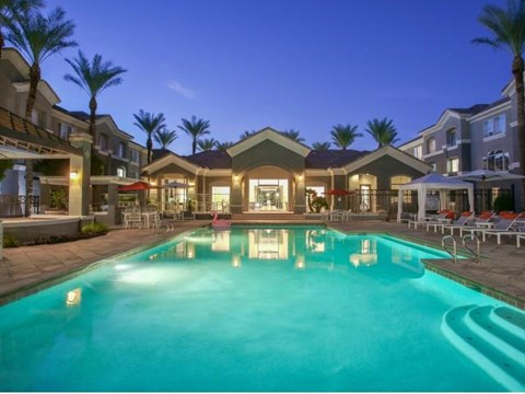 The Highland Apartments Clubhouse pool at sunset