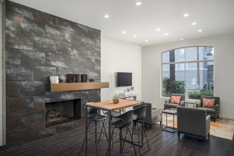 Game Room with fireplace, hightop table, and seating area