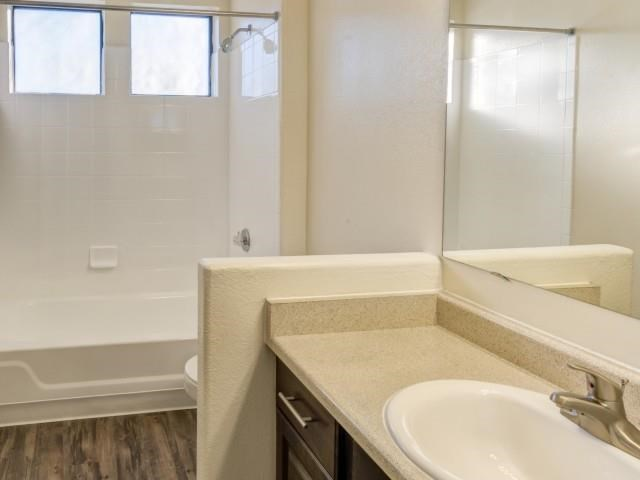 Ingleside Apartments Bathroom with hardwood style flooring and white countertops