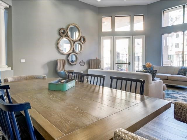 Ingleside Apartments Clubhouse dining table with blue wooden chairs