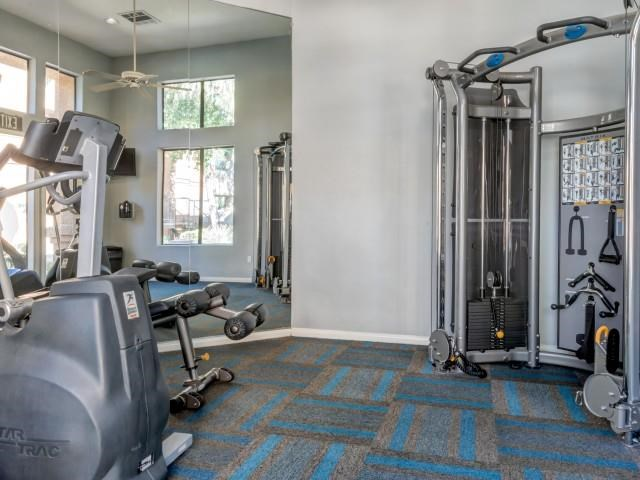 Ingleside Apartments Fitness Center with cardio and weight machines