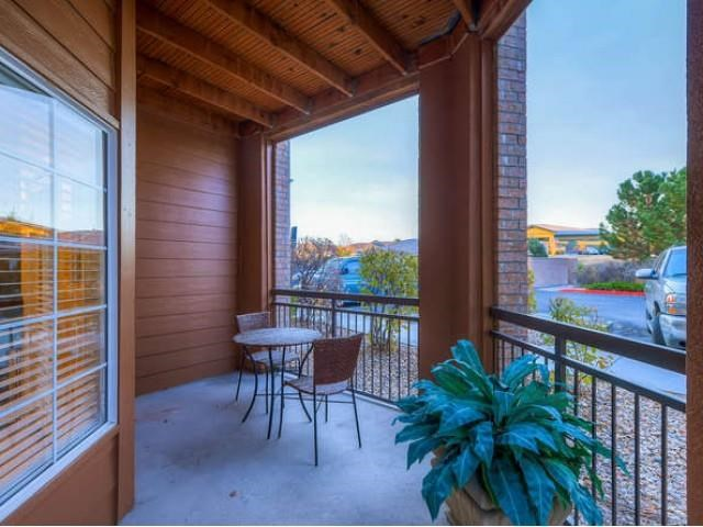 Sonoma Resort at Saddle Rock corner apartment patio with furn, bistro table & chairs looking at the parking lot