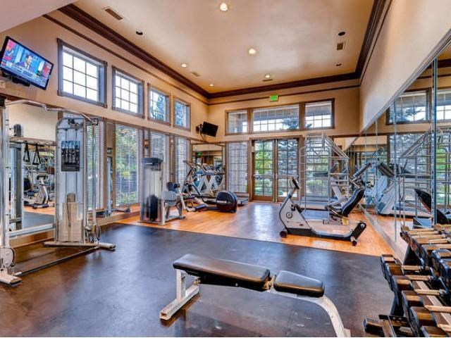 Sonoma Resort at Saddle Rock Fitness Center with free weights, large mirrors, and floor to ceiling windows