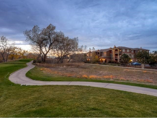 Sonoma Resort at Saddle Rock Apartment building in background with large lawn and pathway at sunset