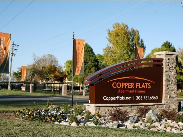 Copper Flats Apartment Homes Monument Sign Surrounded by Lush Landscaping