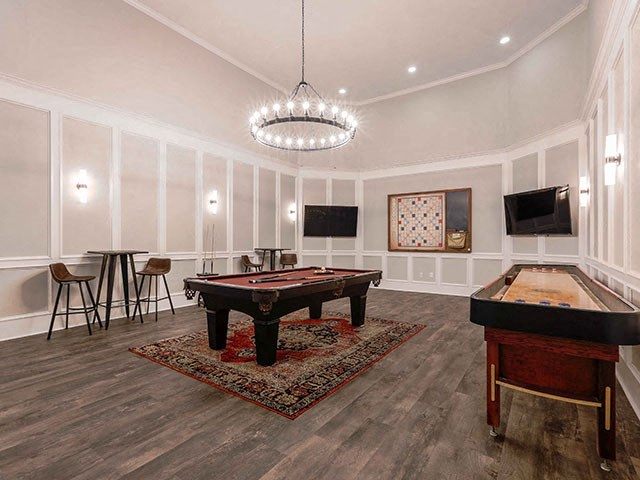 Champions Game Room with pool, and shuffleboard, tv and hardwood floors