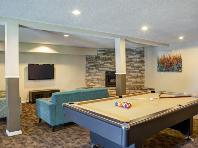 Modern Resident Clubhouse with a Pool Table, Flat Screen TV and Lounge Seating Area