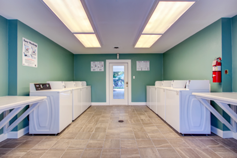 laundry room with washers, dryers, and folding stations
