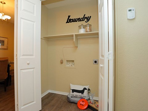 Laundry room with washer and dryer hookups