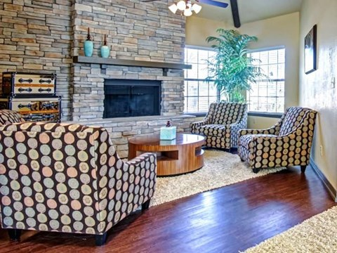Community Lounge with Fire Place and lots of natural lighting