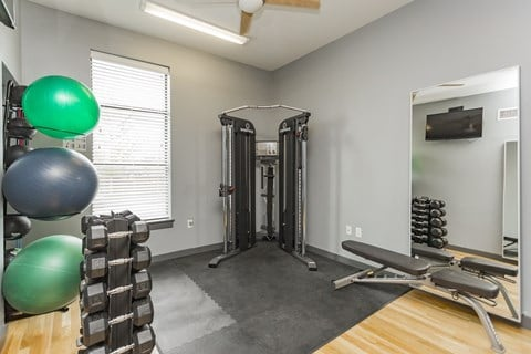 Gale Lofts fitness center weight area