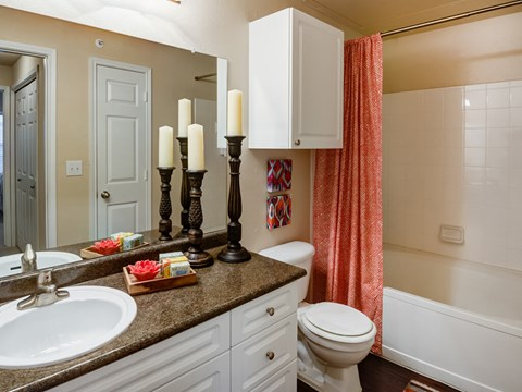 Bathroom with lots of cabinet space and granite counter tops