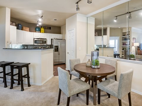 Open concept kitchen with attached dining room