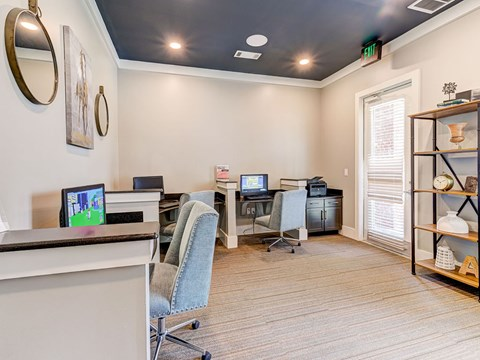 Business center with complimentary wifi, computers and printers.
