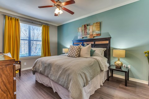Large Master Bedroom with Lots of Natural Light and hard wood floors