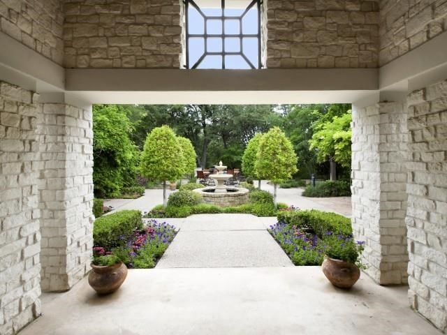 Entrance from inside community to courtyard water fountain feature