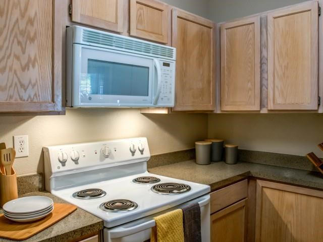 Kitchen with microwave and gas stove top