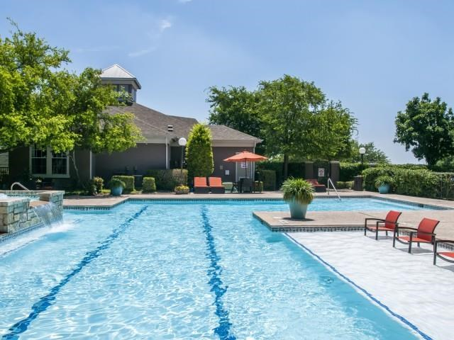 Pool with lap lanes, inside and poolside seating in front of Clubhouse
