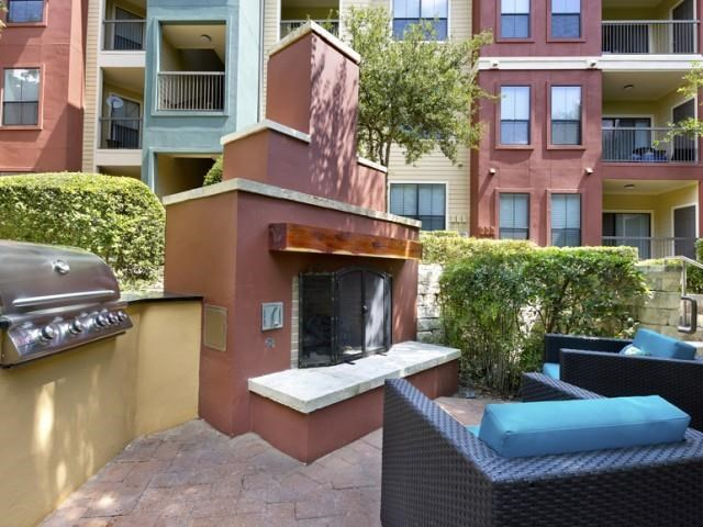 Outdoor fireplace with grill bar