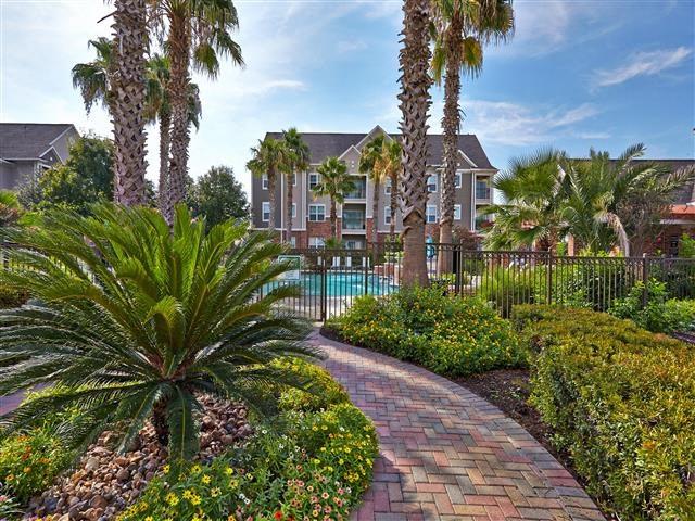Lush landscape walkway to pool