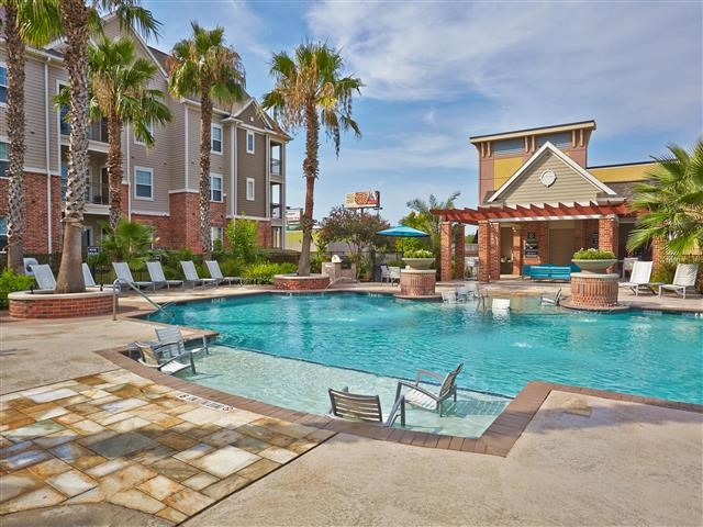 Pool with sundeck and poolside seating