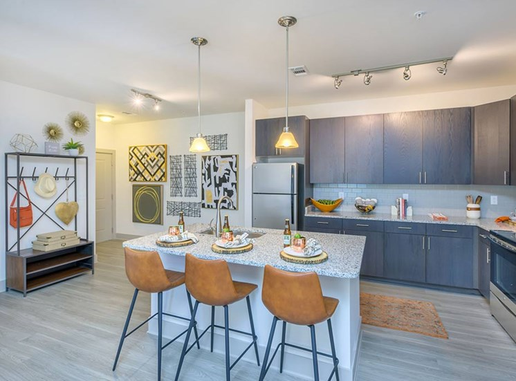 European-Style Kitchen With Breakfast Bar at The Haven at Rivergate, Charlotte, North Carolina