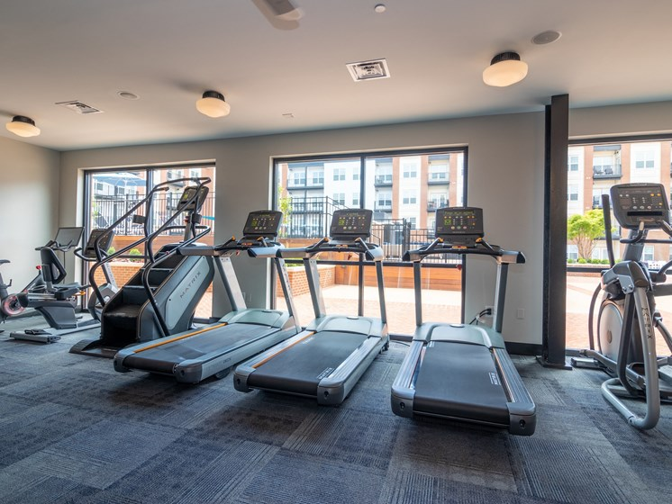 Treadmills in the Fitness Center face Penstock Quarter's bright interior courtyard.