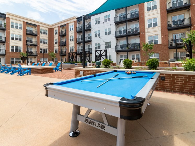 Hang out and get in a game at the pool table in the courtyard.