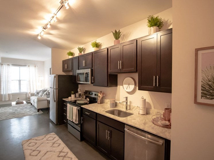 All kitchens at Penstock Quarter apartments in Henrico VA feature Stainless Steel Appliances, granite counter tops and an under mount sink.