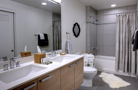 Large Soaking Tub In Master Bathroom with A Tile Surround at Berkeley Central, California