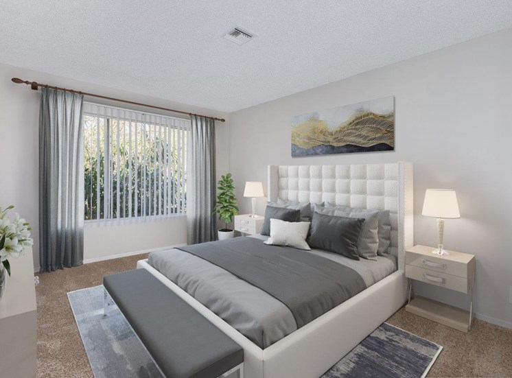 A carpeted  bedroom features a large bed with gray accents, nightstands with lamps, a large window with vertical blinds.