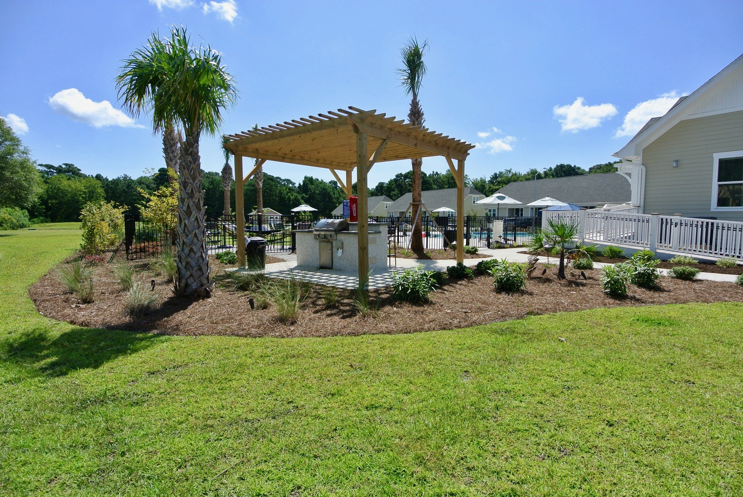 Luxury Townhomes in Wilmington, NC - Myrtle Landing Outdoor BBQ Grill Pavilion Surrounded by Lush Landscaping
