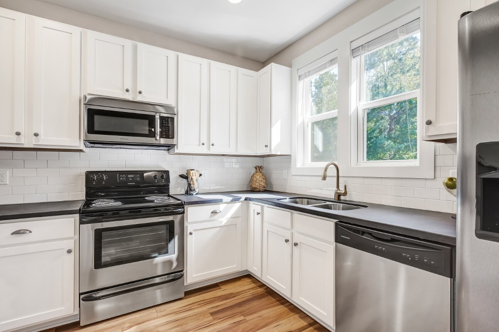 Wilmington Apartments - Myrtle Landing Kitchen with White Cabinets, Stainless Steel Appliances, and Ample Counter Space