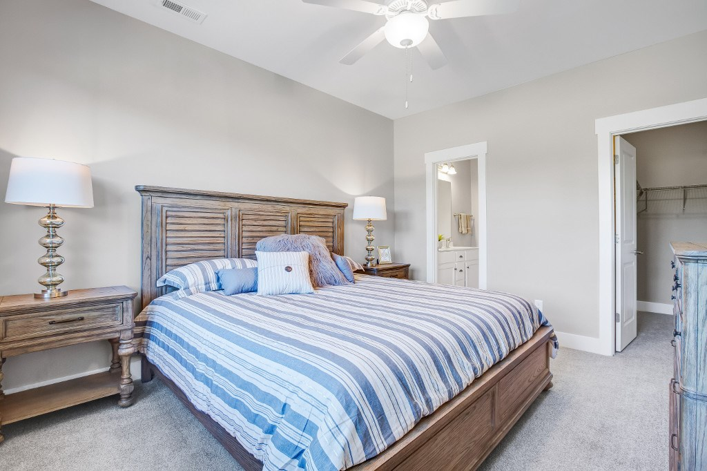 Two and Three Bedroom Apartments in Wilmington, NC - Myrtle Landing Master Bedroom with Carpet Floors, Ceiling Fan, and Attached Bathroom and Walk-in Closet