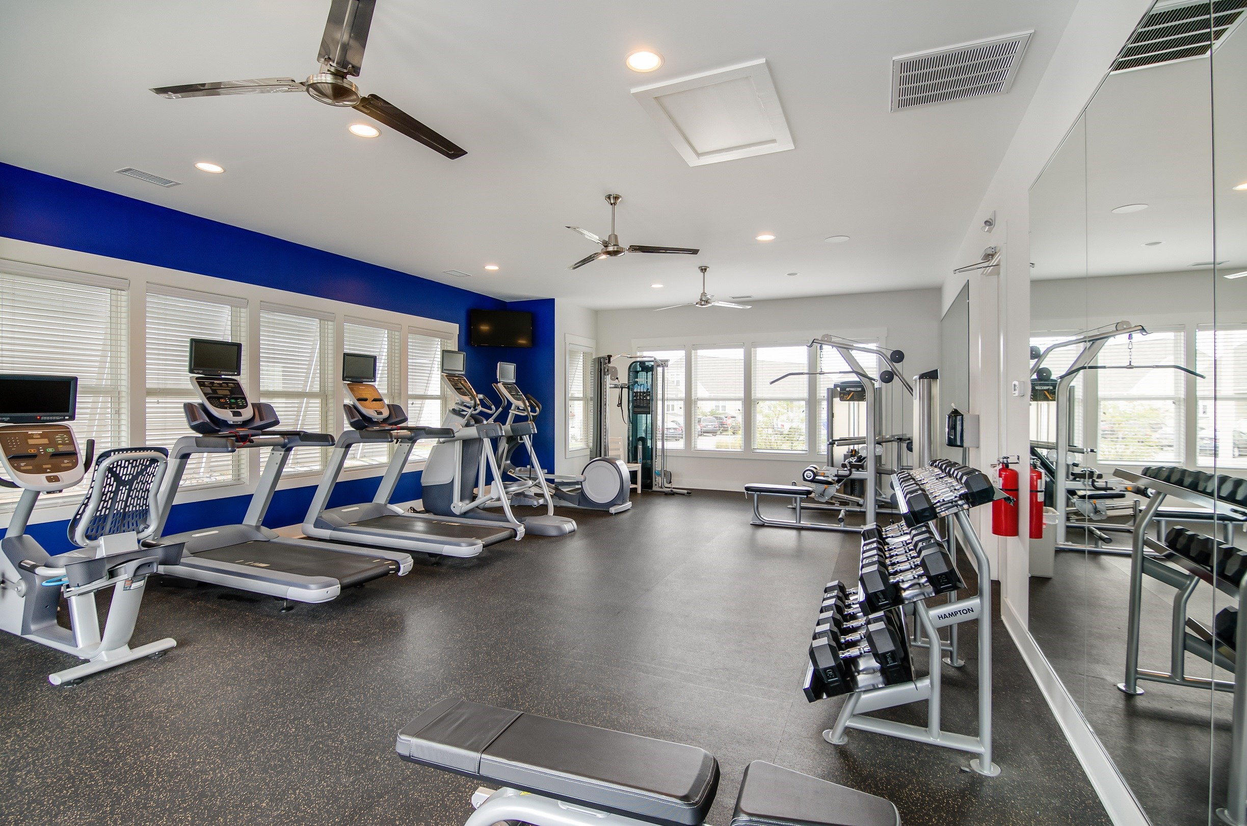 Wilmington, NC Apartments - Myrtle Landing 24-Hour Fitness Center with Ceiling Fans, Cardio Machines, and Free Weights