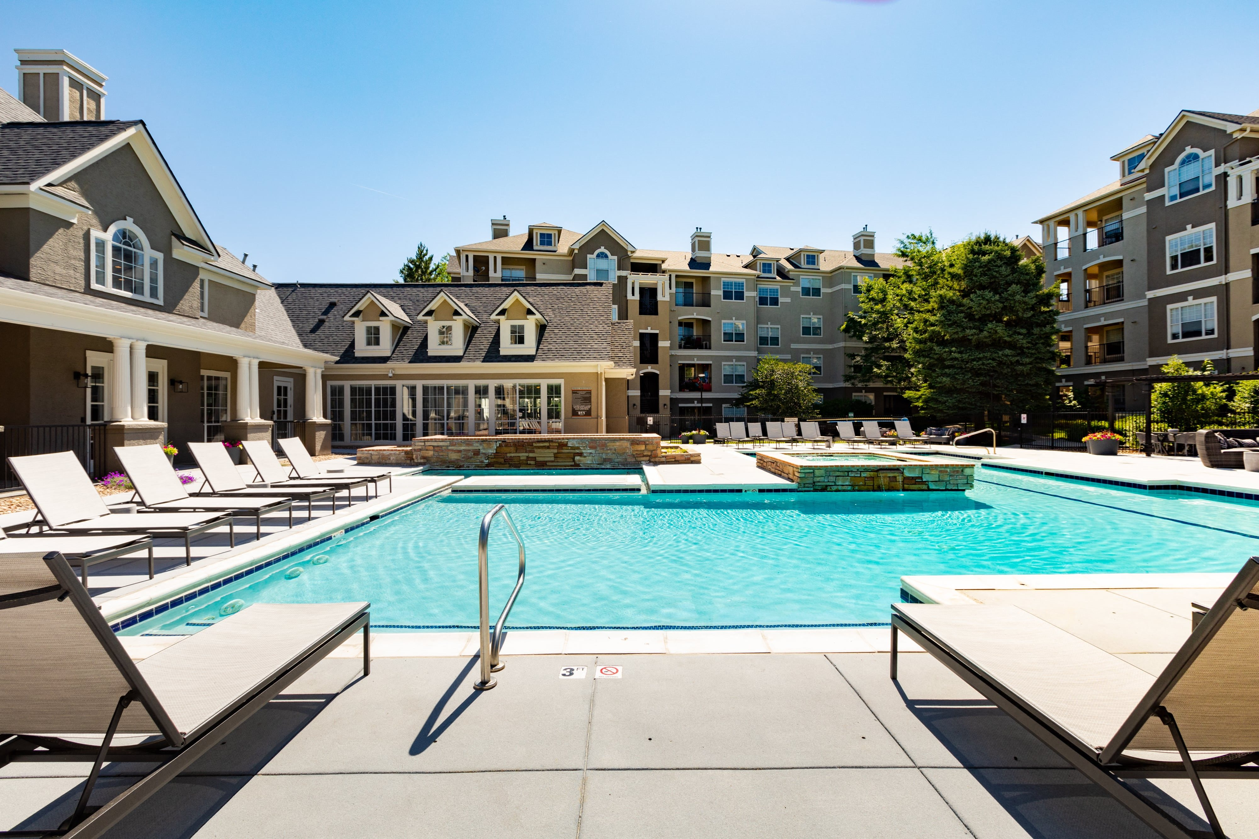 heated swimming pool and lounge area | Greenwood Plaza Apartments in Centennial, CO