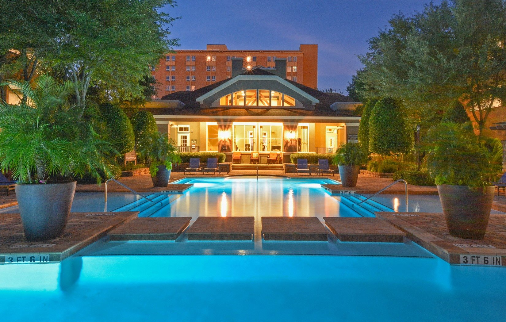 pristine pool with water geyser | Villas at Hermann Park Apartments in Houston, TX