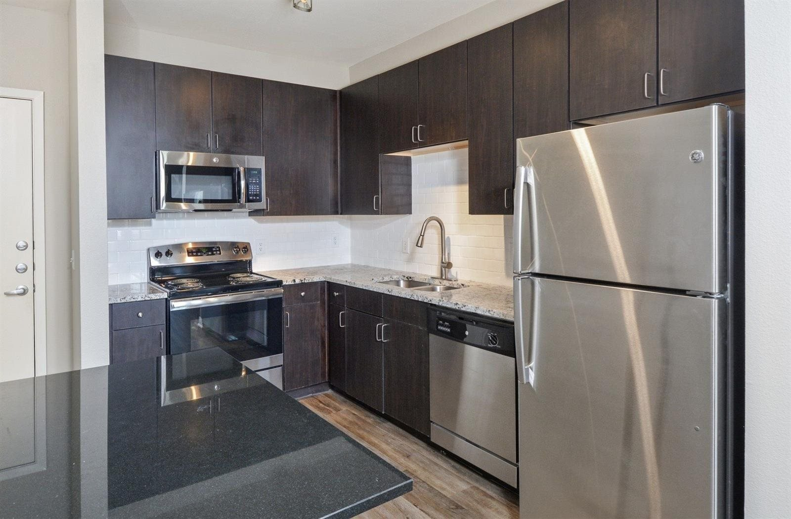 kitchen with cleansteel appliances | Parkside at Firewheel Apartments in Garland, TX