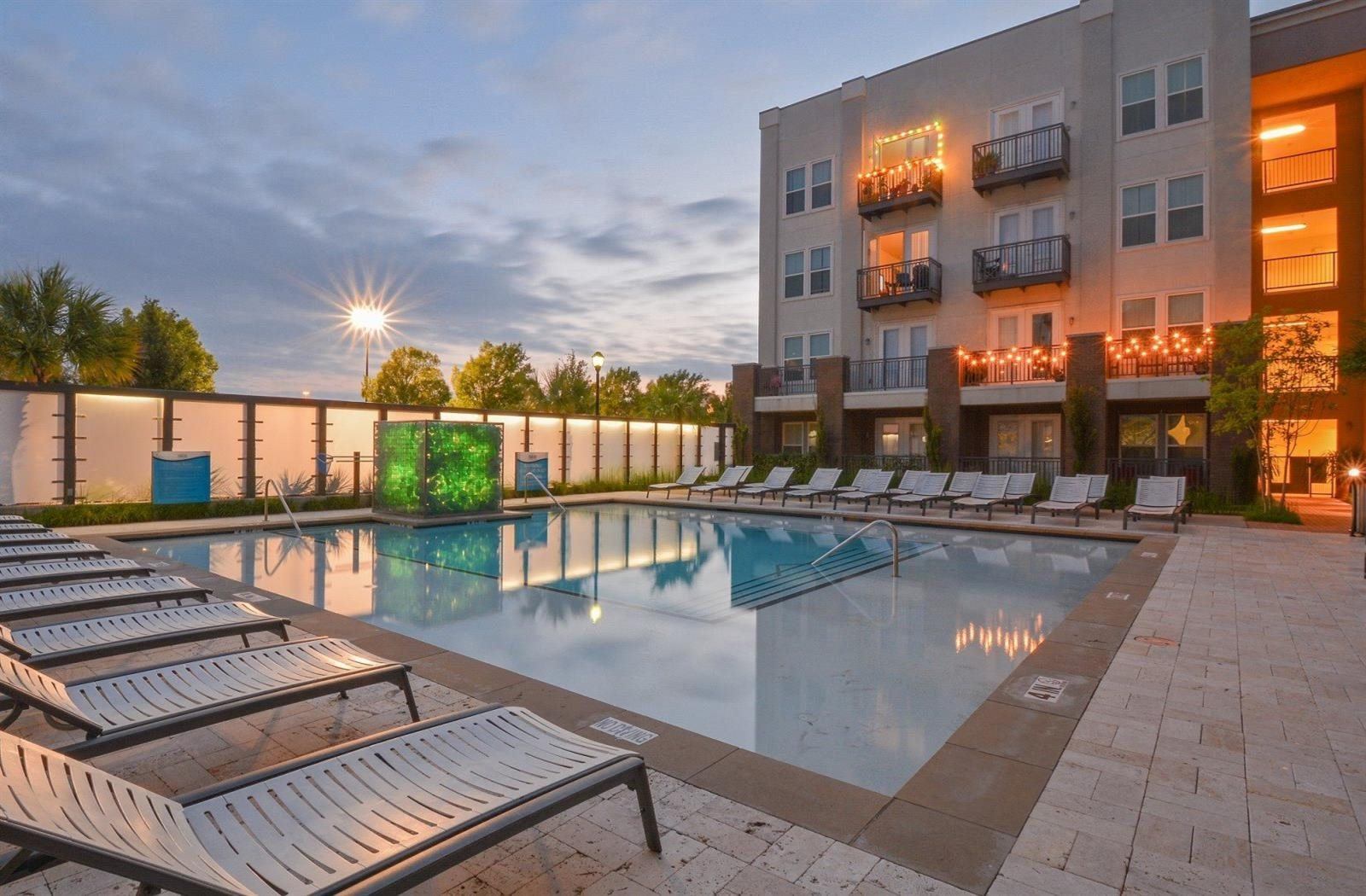 sparkling pool with sundeck | Parkside at Firewheel Apartments in Garland, TX