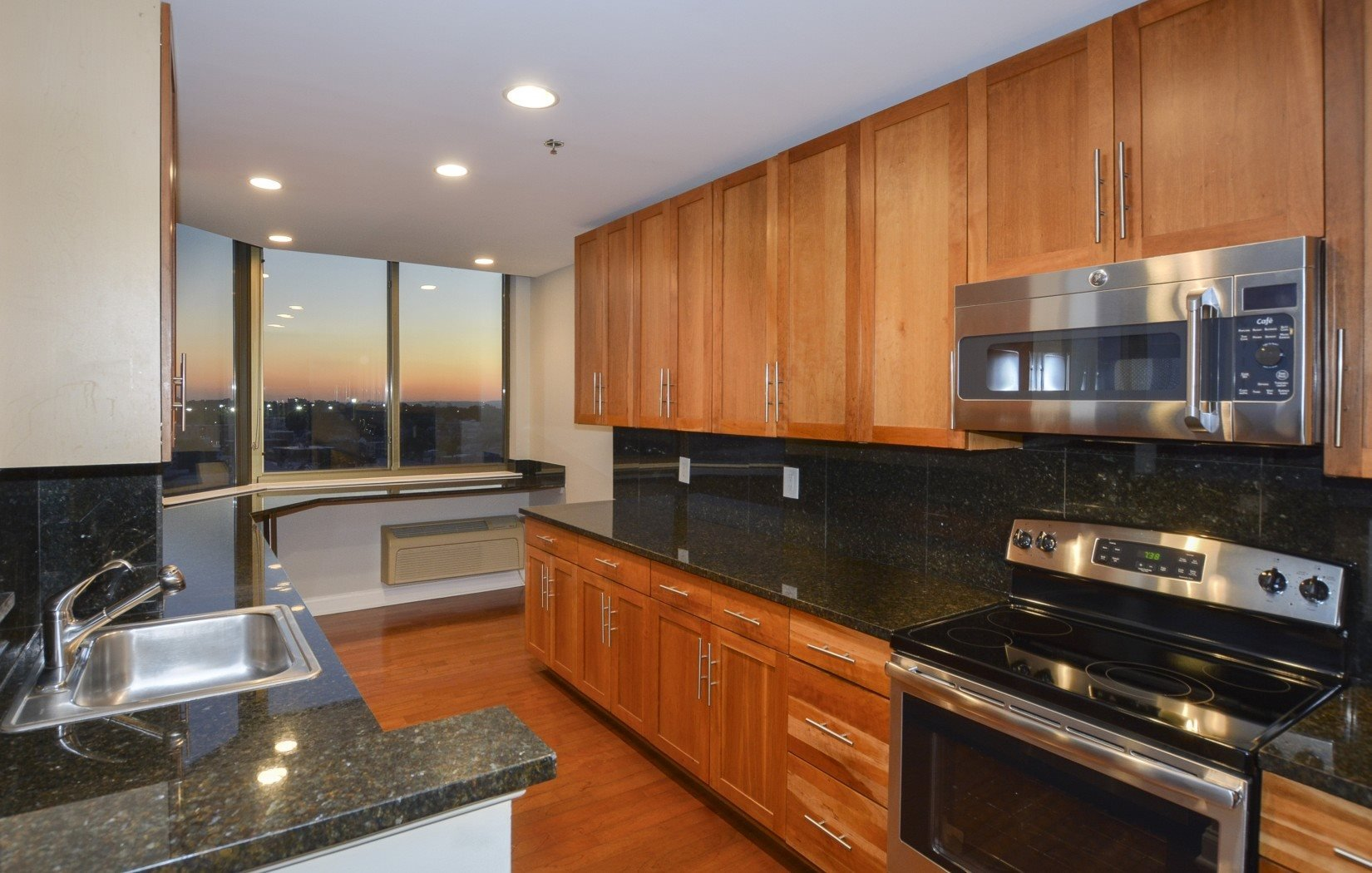 gourmet kitchen with stainless steel appliances | Riello Apartments in Edgewater, NJ