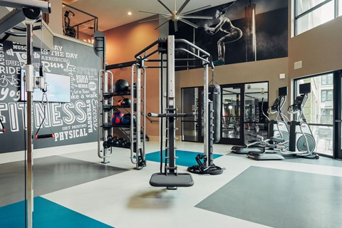 24-hour fitness center with free weights & cardio machines
