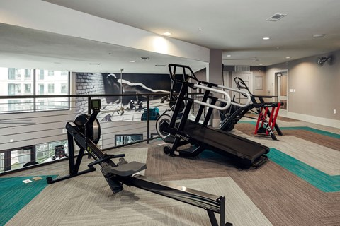 24-hour fitness center with cardio upstairs level