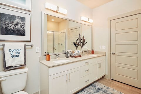 Framed bathroom mirrors and 5-panel interior doors