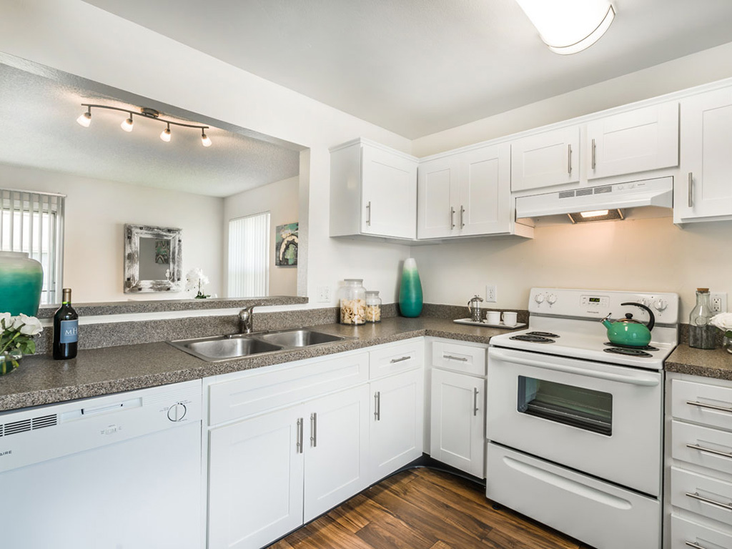 Antique white cabinets make your kitchen airy and light at Aqua Links, Sanford, FL