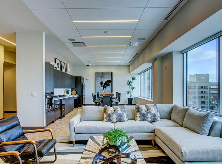 Apartments for Rent in Kansas City-The Grand Apartments Living Room With Large Windows With City View And Modern Decor