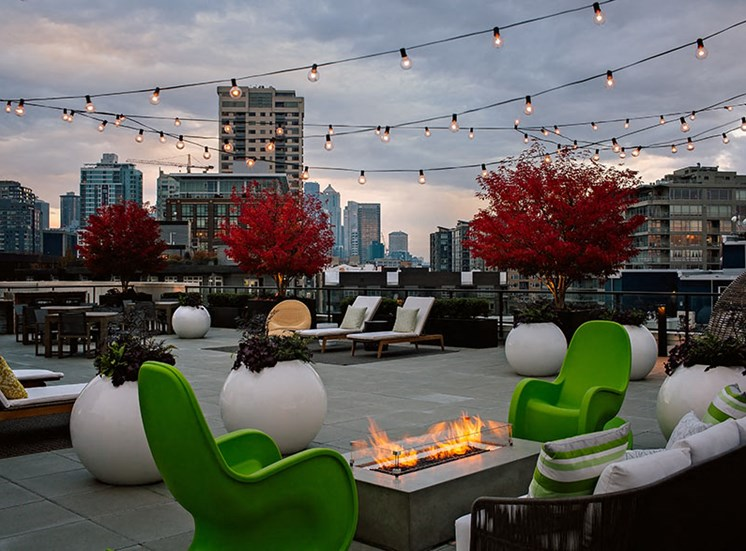 Rooftop Deck With Outdoor Seating & Fire Pit At Clarendon Apartments in Seattle, WA