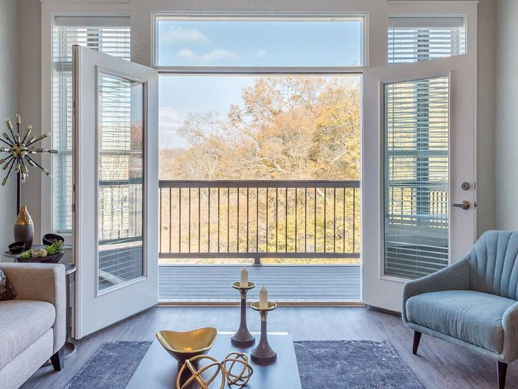 Double doors opened leading to private balcony with picturesque views at Overbrook Lofts in Greenville, SC 29607